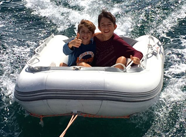 Thiago and Lucas enjoying a bit of speed behind the yacht