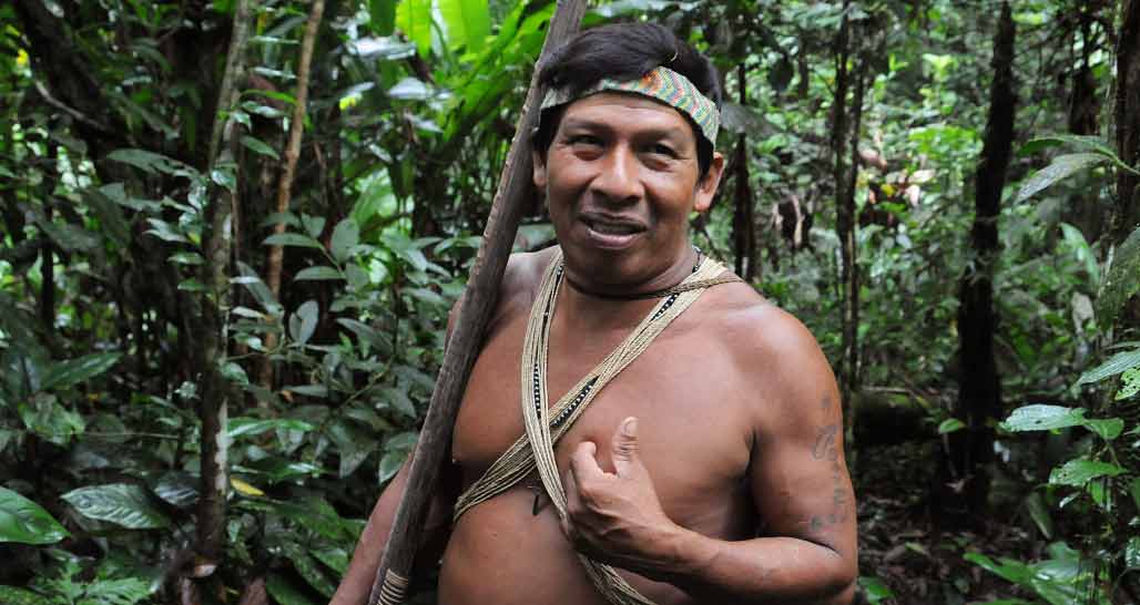 Huaorani elder with blowpipe in the forest