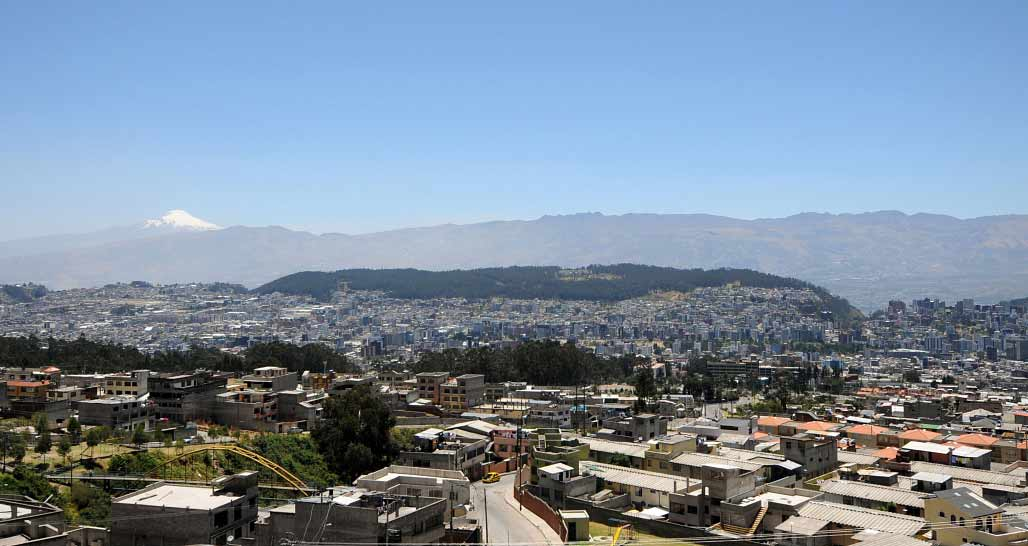 Quito skyline - Cayambe Volcano in the distance