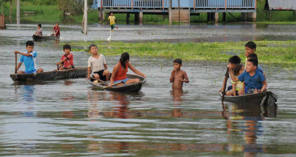 Children Playing in Amazon River